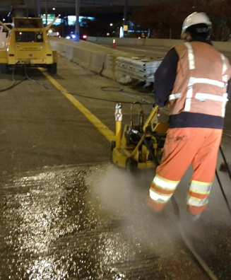 Line striping removal with waterjetting