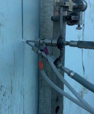Abrasive water cutting of fuel tank door