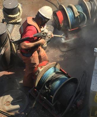 Tugboat deck-coating removal